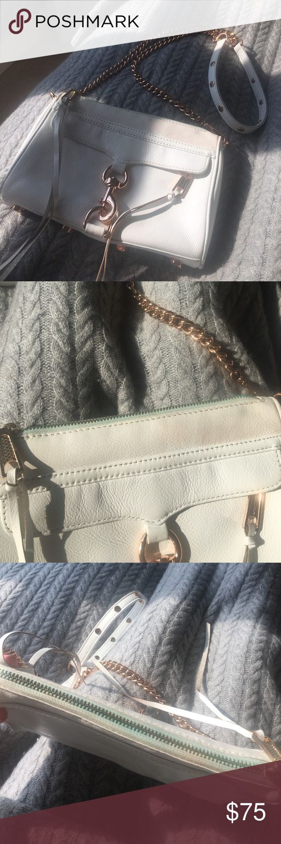 Rebecca Minkoff limited edition mini mac White This is my favorite bag, I unfortunately had nail polish on the inside fabric and was able to get it out however it soaked into the zipper and too part of the leather by the zipper, the zipper is green but cannot be seen from the front or back. The leather near the top is an odd white the rest of the bag is very nice white. Still in great condition otherwise! Strap has no insides or stains it's in  very good condition. they don't make this bag…