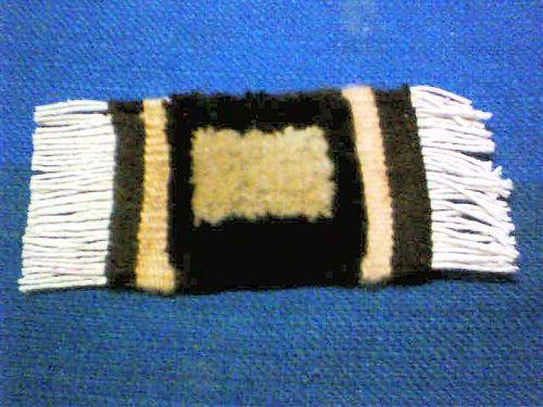 miniature woven carpet