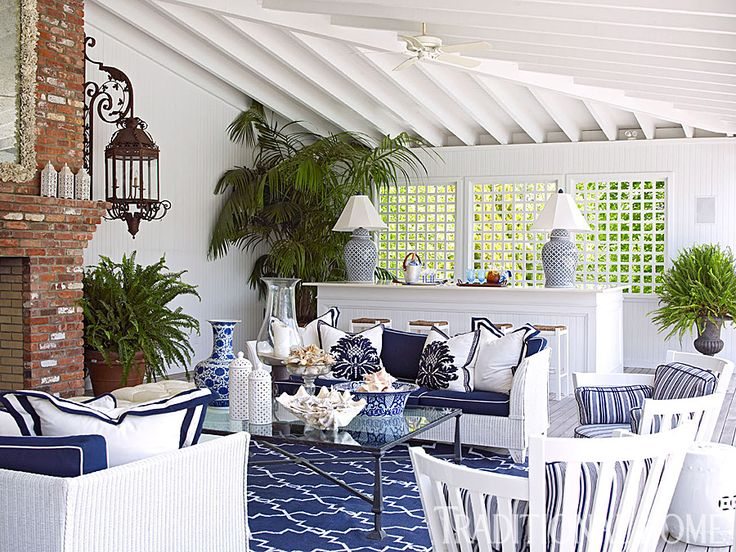 The blue-and-white porch living area is complete with a bar. - Photo: Tria Giovan / Design: Kenneth Alpert