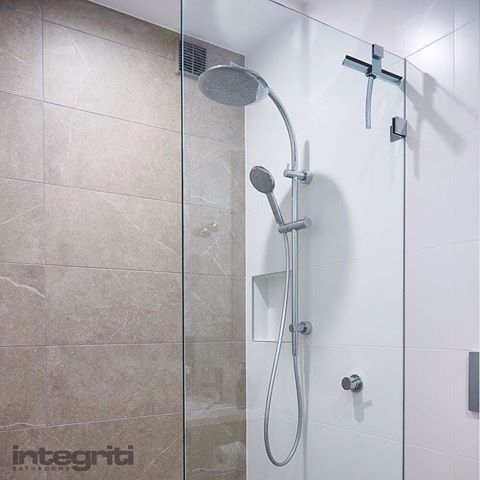 A rain showerhead is the ultimate form of luxury and a frameless glass door across the shower area the epitome of a modern bathroom. Wouldn't you love to be coming home to one of these today! #integritibathrooms #rainhead #shower #bathroomdesign #bathroom #bathroomdecor #bathroomtiles #bathroomdesign #bathroomdesigner #sydneybathroom #sydneybathrooms #sydneyrenovations #sydneybathroomdesign #sydneybathroomdesigner #sydneybathroomrenovations #shower #showerhead