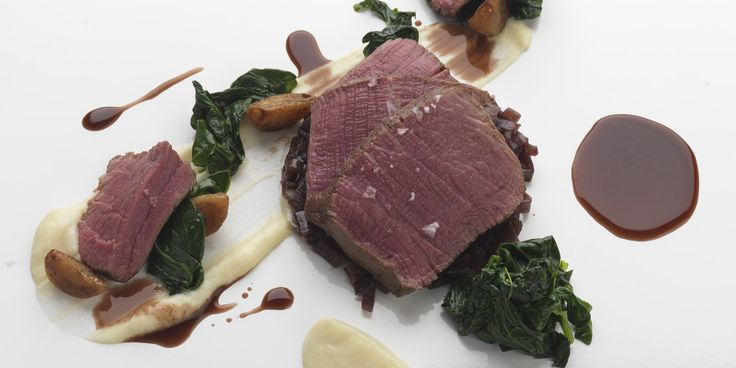 Fillet of beef, shallot marmalade, celeriac purée and essence of port. A slow-cooked beef recipe is given a twist by renowned chef Daniel Clifford. Confited garlic and shallot marmalade ensure the tender beef is well accompanied
