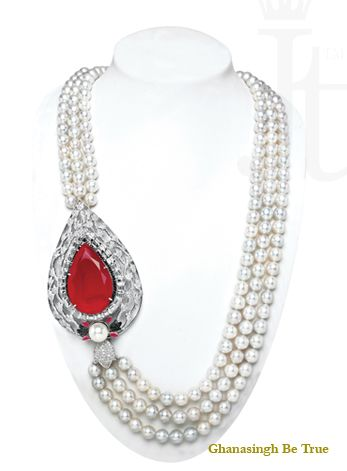 Necklace: The classic broach with 63 carat #ruby is enhanced with a line of black #diamonds and bed of baguettes. The signature tulip motif surrounds a beautiful Ruby .The artistically crafted broach is strung with grey south sea pearls making the piece classier. | #beautiful  #jewelry #necklace