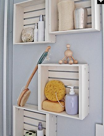 Crate Shelving..  For easy, budget-friendly storage, Ana purchased and painted inexpensive crates from a craft store to create a decorative and functional storage solution. Hang them on a wall to save space, or keep them at hand on the vanity.