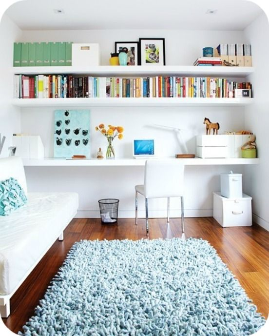 Shelving to incorporate a home office space within a living area.