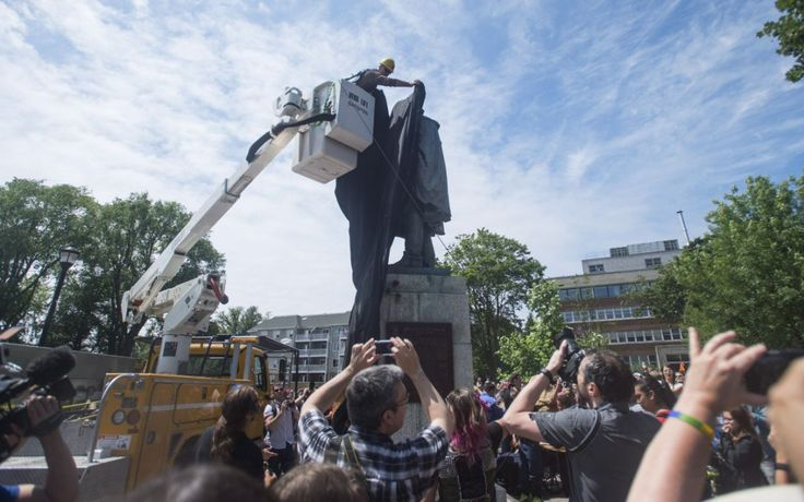 The statue of Edward Cornwallis in Halifax is covered with a black tarp.