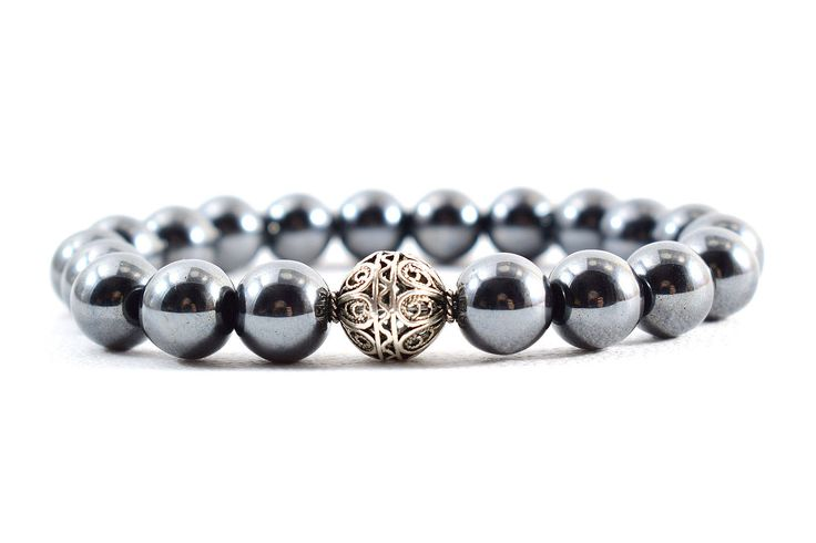 Unisex Beaded Bracelet, featuring 10 mm Hematite Gemstone Beads, and a 11 mm Sterling Silver Beads in the middle. A handsome piece of jewelry for the classy Man and Woman.