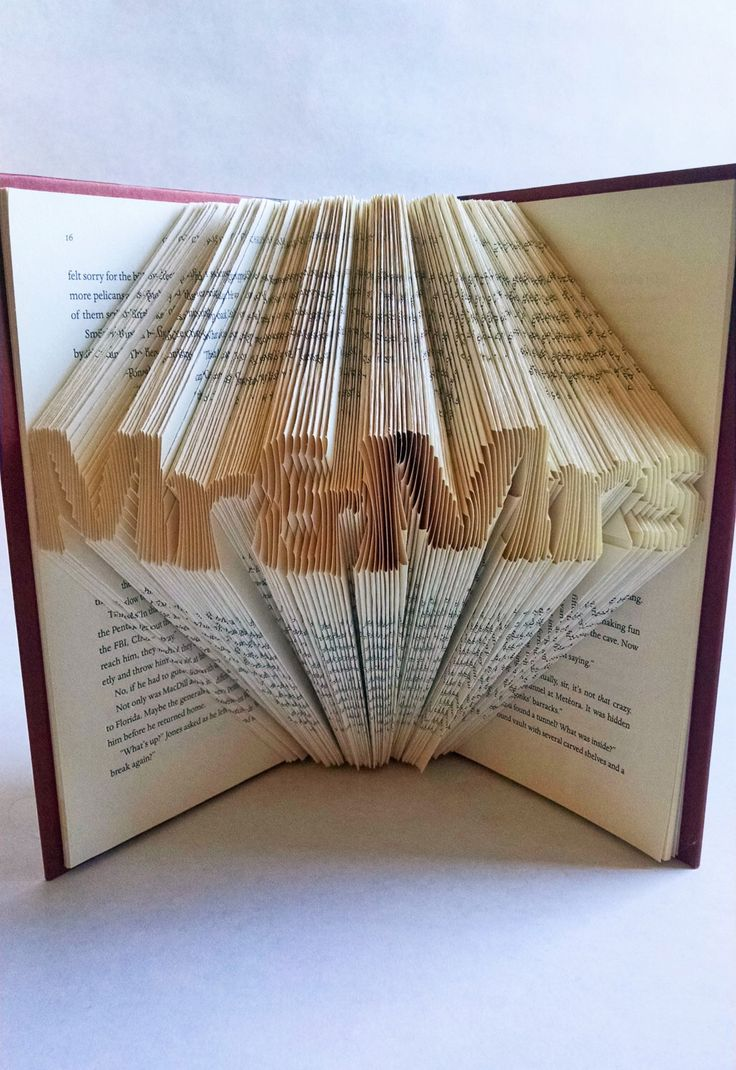 "Wedding Centerpiece for Book Themed Wedding - Folded Book art Featuring the words ""Mr & Mrs"" by FancyMadeFits on Etsy https://www.etsy.com/listing/261041773/wedding-centerpiece-for-book-themed"