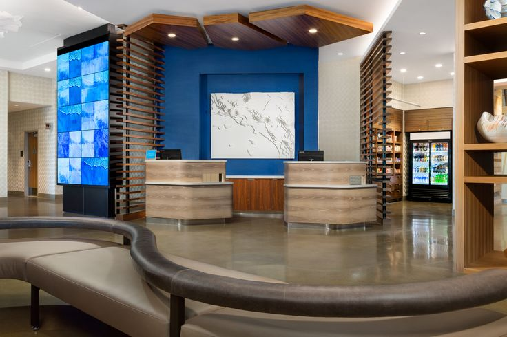 The front desk at the Courtyard Marriott Santa Monica designed by HBA Studio.