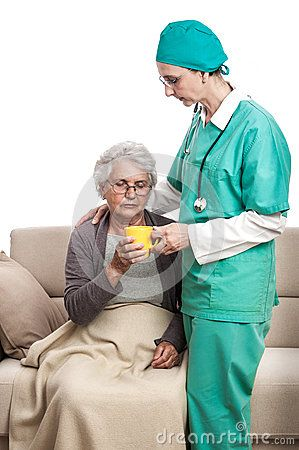 Home visit. A female doctor giving a cup of tea to an old disabled woman. Senior taking pills.  on white.