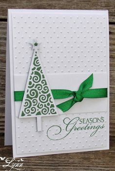 the tree on this card gives me inspiration for a little diy of my own.... green construction paper and you could make the with pattern out of white fabric paints or glue that dries white.. and maybe even glitter!