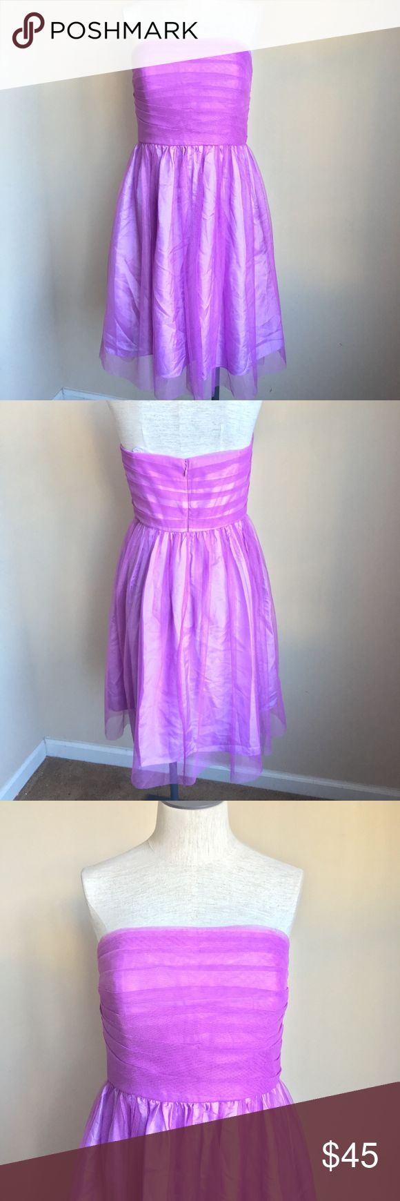 """Donna Morgan Tulle Strapless Dress Lilac Purple Donna Morgan Tulle Strapless Dress Lilac Purple  Womens size 6  100% Polyester  Great condition with no visible flaws  Strapless  Zips up the bak  Measurements taken while laying flat:  """" armpit to armpit """" length  """" waist Donna Morgan Dresses Strapless"""