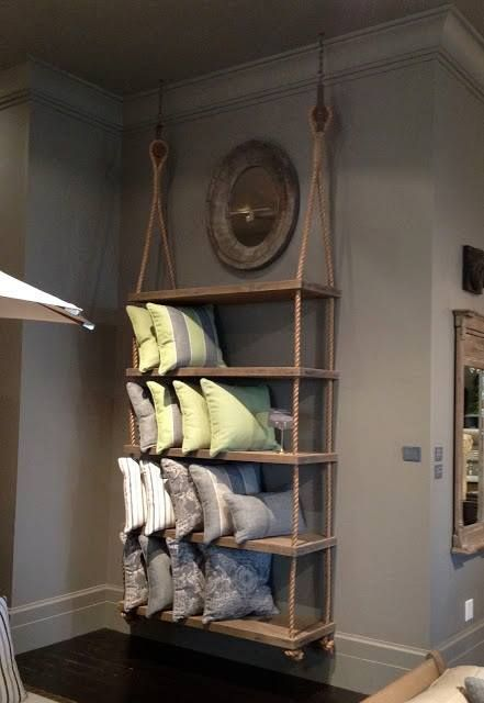 Rope and plank shelves... nice idea for a nautical themed home via http://www.drivenbydecor.com/2012/05/creative-ways-to-use-rope-in-your-homes.html