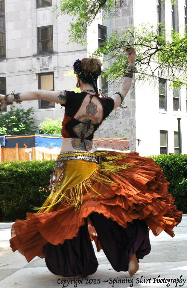 Tribal Fusion bellydancer in bright yellow & orange skirt