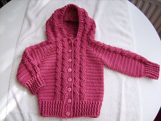 Twisted Cable Button Up Hoodie Free Pattern Sizes 6m-1yr, 2, 4, & 6. My current project for Conlaed using Lion Brand Vanna's Choice Yarn in Dk Brown. ~YW