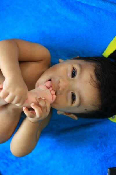 Toes licking..in our malay culture, our myth said that, when your baby licking his toes mean that he/she does want to has a younger sister/brother