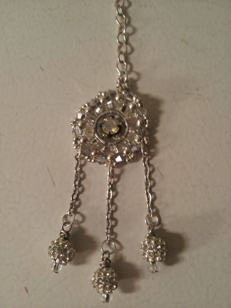 Purse fob - This piece is a hand beaded medallion comprised of Swarovski crystals and Preciosa glass with a montee accent in the center and rhinestone encrusted dangles.