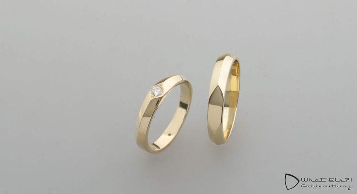 Geelgouden relatieringen met diamant