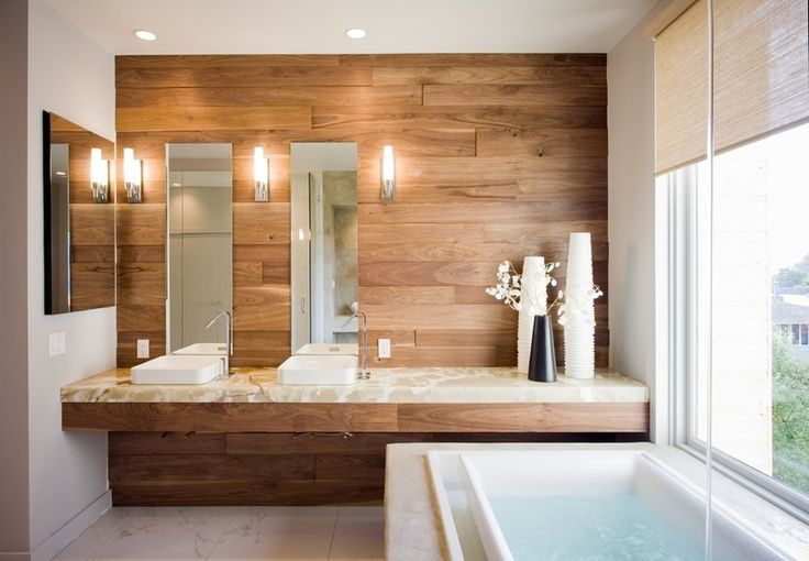 Contemporary Bathroom by Mark Brand Architecture l The luxe bath seen here features marble floors and an onyx countertop, as well as a walnut-plank feature wall.