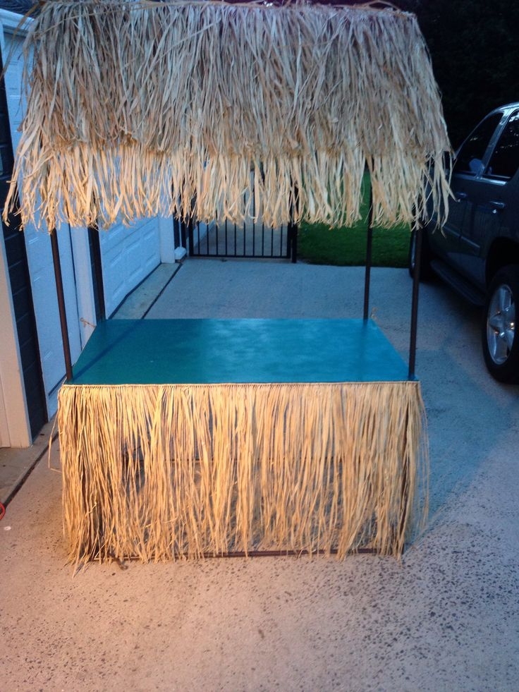 DIY Tiki Hut this is without the decorations.  Made with PVC, rope, card board and table skirt cut in half.