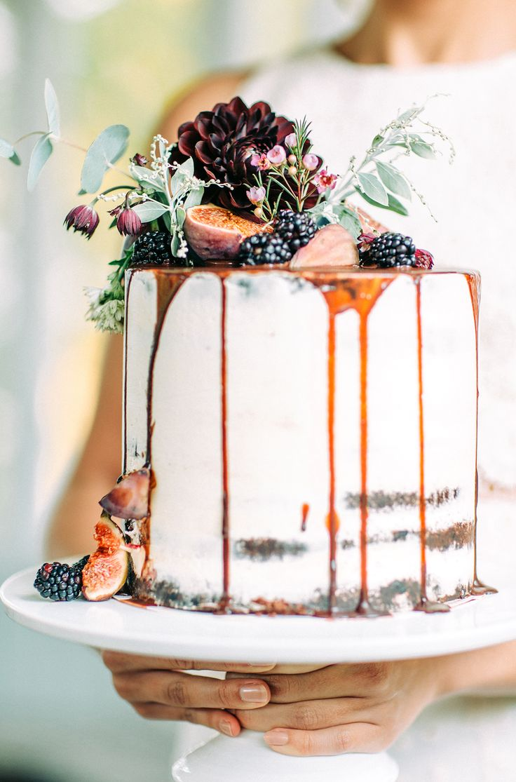 The Hottest Trend in Wedding Desserts: Drip Cakes | Simple + Elegant Woodland-Inspired Cake topped with caramel and berries