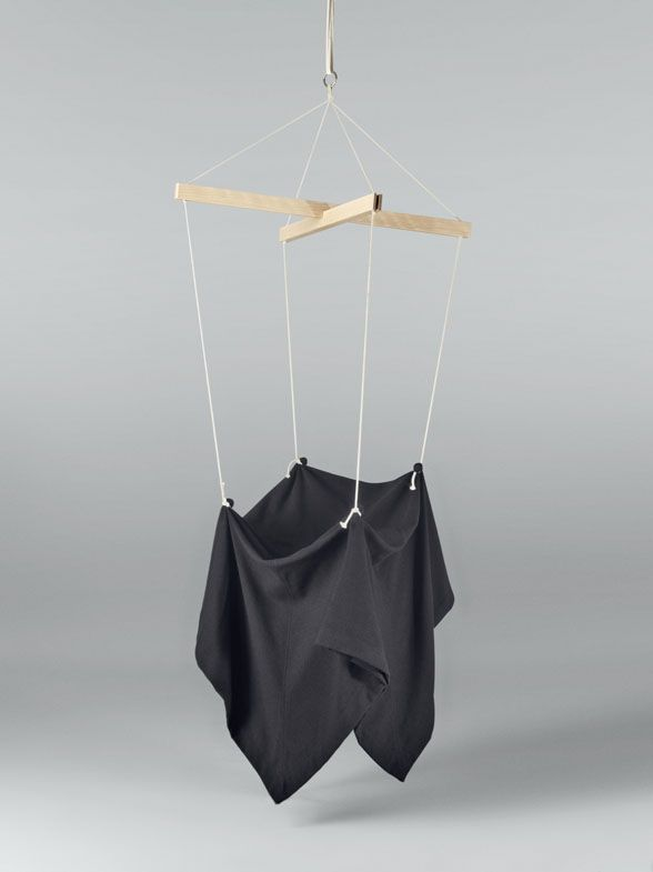 Martín Azúa Studio - Silla Marioneta. 'Puppet Chair' in English is designed by the Barcelona-based Martín Azúa, and comprises simply a piece of Hallingdal cloth held in four points and suspended in the air. Minimal and magic, the chair seems to float and moves just like a puppet. 'We often forget that the beauty of objects can be solved with basic resources,' says Martín Azúa. In this case the Hallingdal textile is directly the chair.