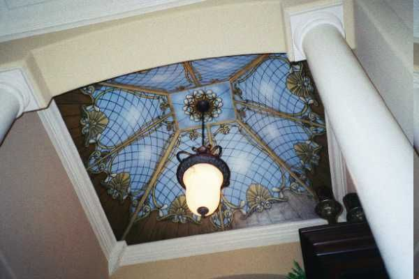 This trompe l'oeil ceiling is painted on canvas. This is the ideal method of painting stain glass since there are so many measurements and lines to paint. All of the murals on this page were painted on canvas. They can be shipped to your home and installed by a professional paperhanger.