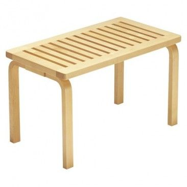 "The Bench 153 by Alvar Alto  Material(s): Birch wood  Dimensions:  Short bench: 17.3"" H x 28.5"" W x 15.7"" D  Long bench: 17.3"" H x 44.3"" W x 15.7"" D"