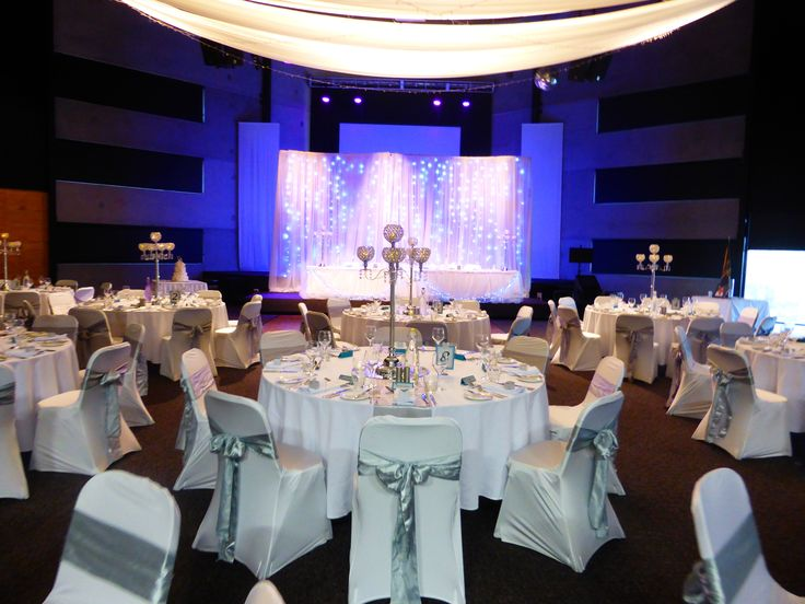Silver sashes on the chairs with silver candelabra's are an amazing combination