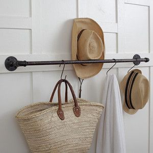 Entry coat hanger - could also work for towels in the bathroom