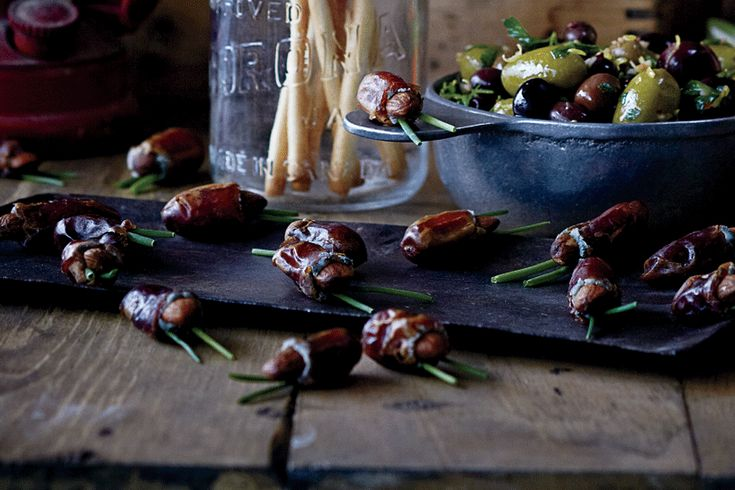 Bug-like dates are stuffed with blue cheese and almonds, making them the perfect sweet and salty treat for Halloween.  Image: Jeff Coulson   Food Styling: Claire Stubbs   Prop Styling: Catherine Doherty  #Halloween #Dates #BlueCheese #Appetizer #TestedTillPerfect #CLGetCooking