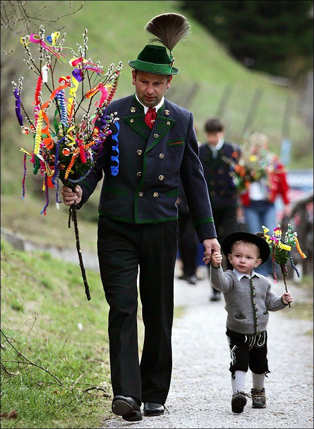 This is a Palm Sunday Tradition - The Bavarians decorate spring branches with ribbons and carry them to Mass instead of palms. Lovely pictures! Photo: Dressed in traditional Bavarian highland attire, a German boy ... / LJWorld.com