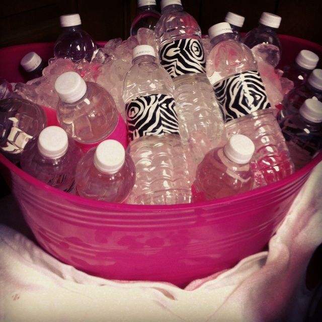 Water bottles wrapped in zebra print and hot pink duct tape to match baby shower theme.