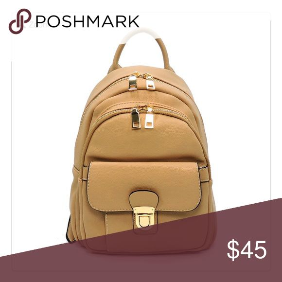 NEW Fashion Push Lock Pocket Backpack NEW Fashion Push Lock Pocket Backpack Designer inspired handbag Faux vegan leather Zip top closure Gold-tone hardware L 8.5 * H 11 * W 4.5 Small Size Taupe Color Shown First Photo Only Bags Backpacks