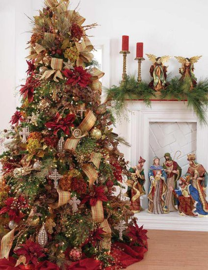 From Christmas Rappings: This tree has layers of wide ribbon (which is dramatic and takes up a lot of visual space) and large poinsettias.  The gold tones and rich reds really give this tree an air of sophistication, almost decadence.
