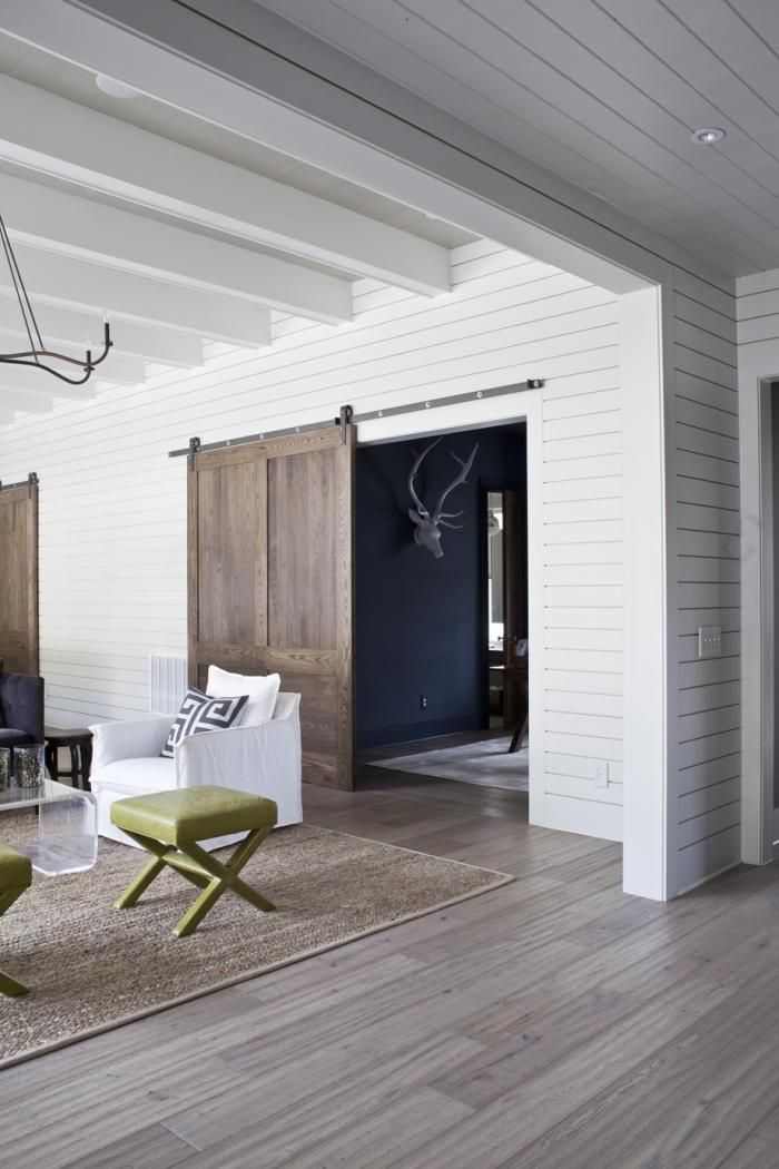 Heather A. Wilson's new build of classic bungalow in Charleston, South Carolina, sliding wood barn doors, interior white wood siding, Remodelista