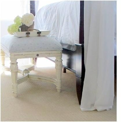 Pretty bench at the end of the bed.