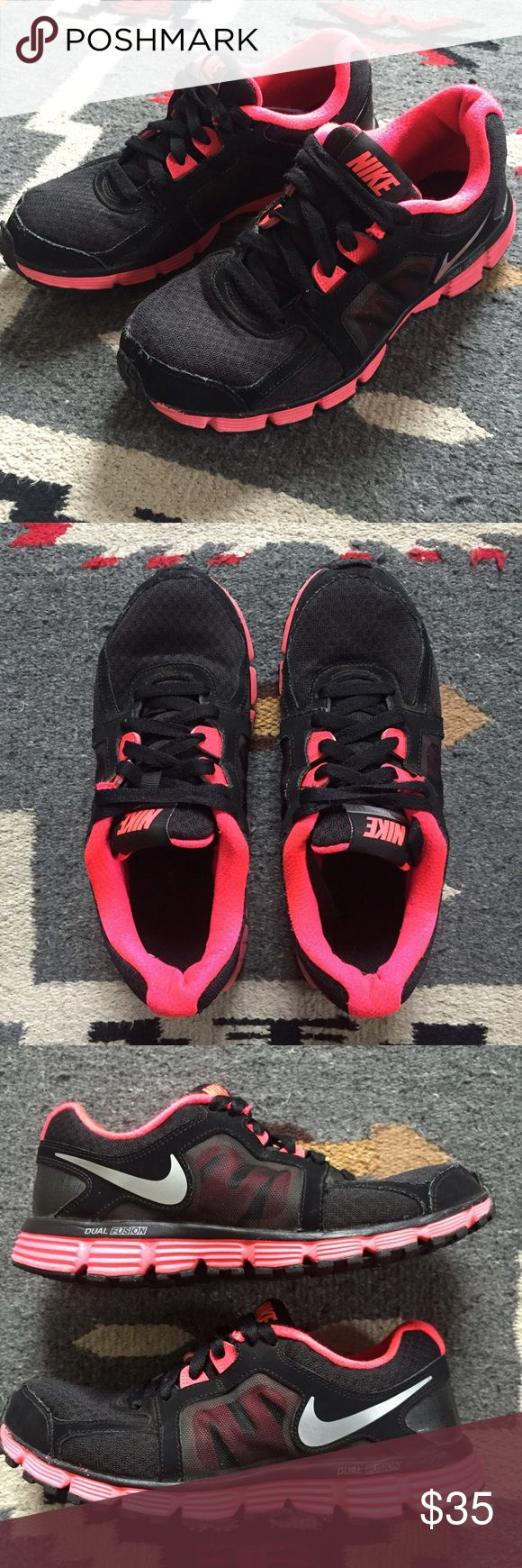 Nike Dual Fusion ST2, size 7.5 black / neon coral Nike Dual Fusion ST2, Women's size 7.5 in black and neon coral colorway. Good used condition. Still has lots of life left! Nike Shoes Athletic Shoes