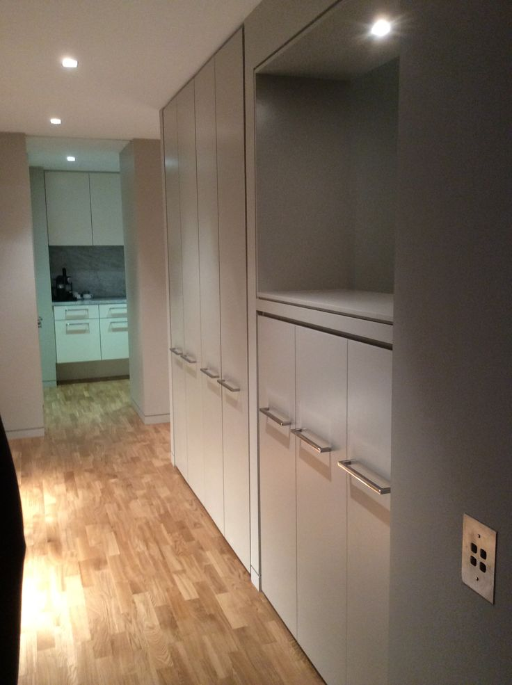 Custom made hallway cabinetry with over-lite display nook