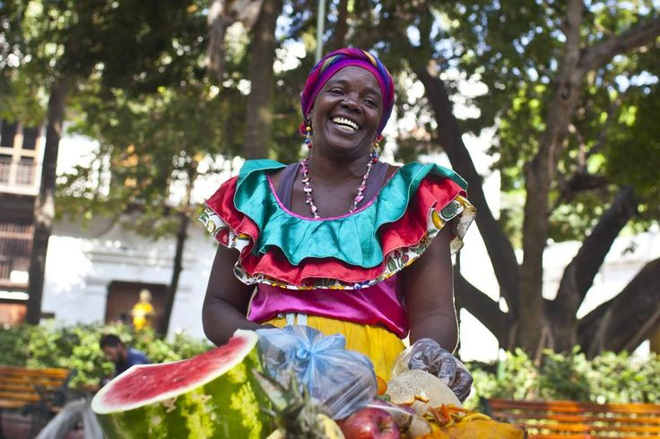 All smiles. The traditional Palenquera of Cartagena. http://ticartagena.com/en/things-to-do/tours-experiences/snap-to-it-with-a-photo-tour-of-cartagena/