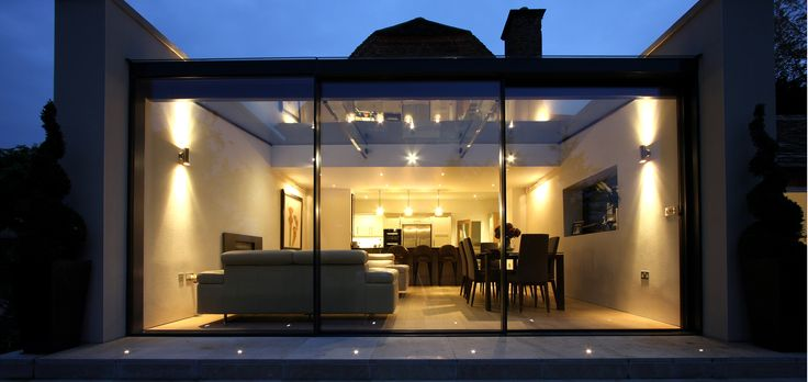 The Garden Room House contemporary glass extension with our slim frame sliding glass doors The Garden Room House is a grade II* listed property.