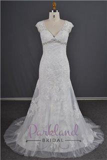 A stunning Parkland Bridal lace wedding dress with luxury beading, v neck, ivory, tulle.
