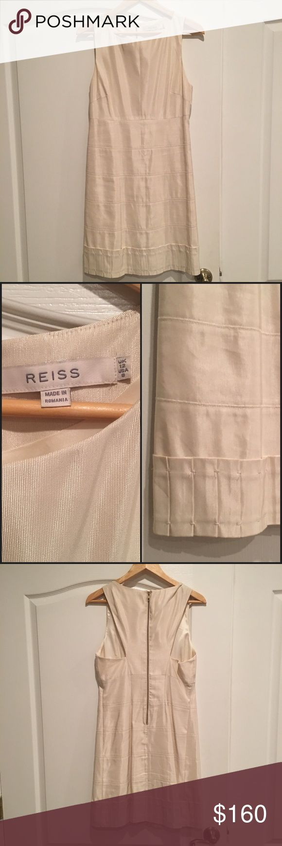 Reiss Ivory Dress with Pleated Hem Gorgeous dress. Wore this just once for my rehearsal dinner. Photos do not do it justice. Size 8. Cool cut outs in the back and Pleated hem. Reiss Dresses