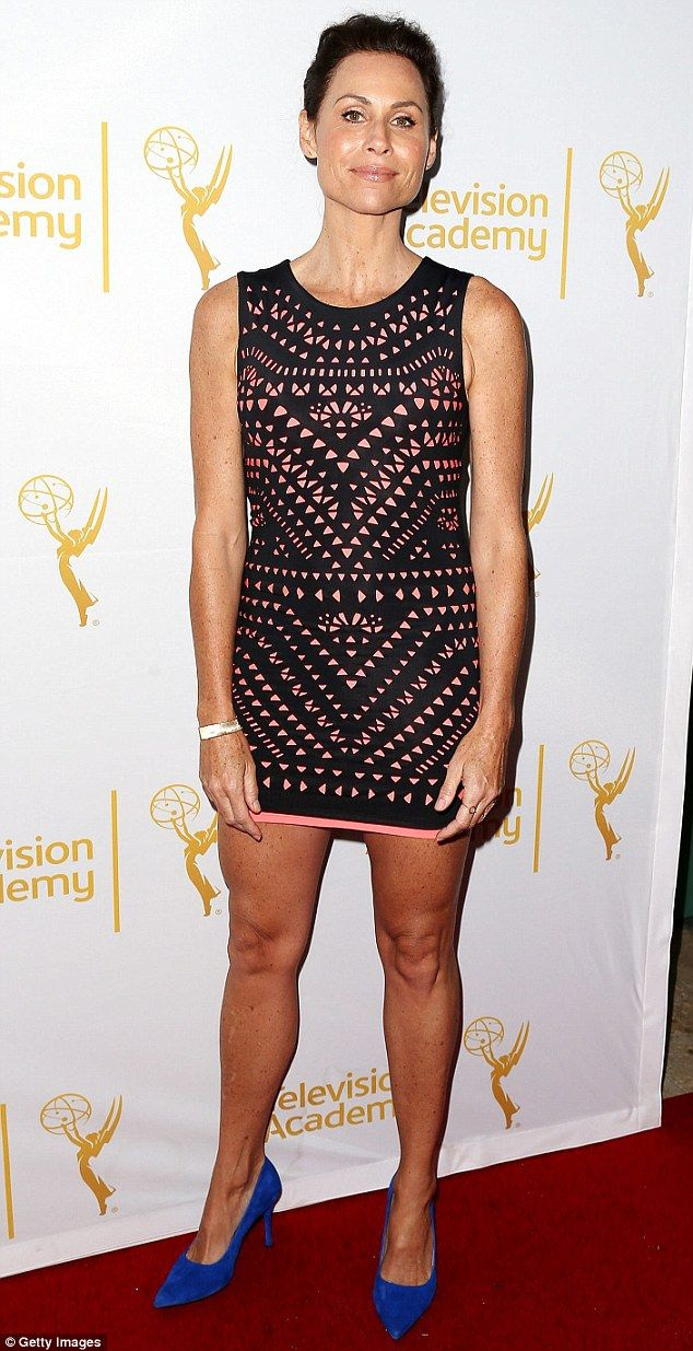 Minnie Driver attends the Television Academy's Performers Peer Group's celebration of the 66th Emmy Awards in a pink patterned mini and blue suede pumps http://dailym.ai/1poMvGy
