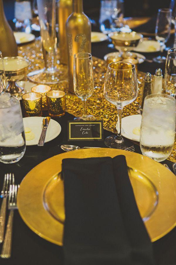 Glamorous black and gold wedding place setting (Photo by Ryan Horban Photography)