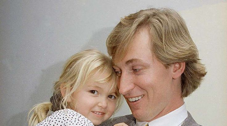 An intimate look at Gretzky's life off the ice throughout his career  -  March 25, 2017:     Wayne Gretzky holds his four-year-old daughter, Paulina, after a press conference in Inglewood, Calif., on Jan. 4, 1993. It was announced that the Los Angeles Kings team doctors cleared Gretzky, who hadn't played all season due to a herniated thoracic disk in his back, to return to the game.