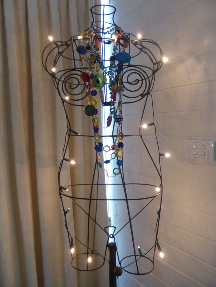 Old wire dressmaker mannequin transformed into funky floor light