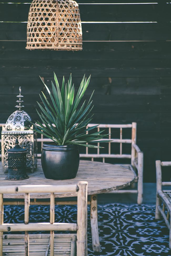 Tile floor, dark burnished plant, woven lamp... seriously stylish and beautiful under a pergola