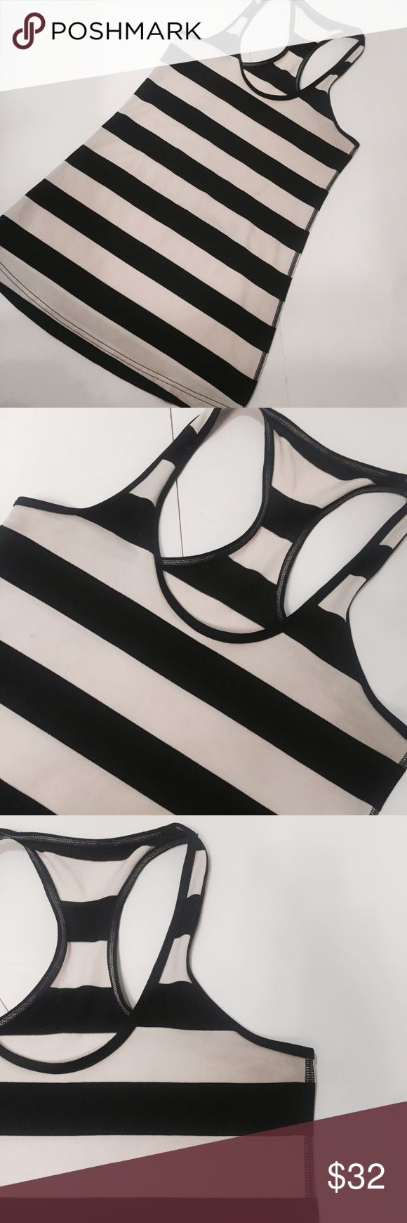 Lululemon cool racerback tank Lululemon black & white striped racerback tank • size small • purchased at the Robertson Blvd location • racerback detail • wear your own bra • macro stripes lululemon athletica Tops Tank Tops