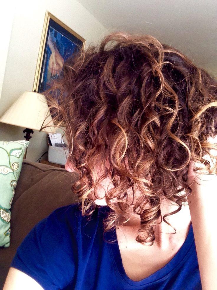 Caramel balayage in short curly hair
