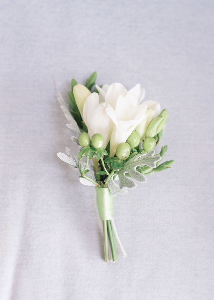 Pasha Belman; To see more casual chic details about this South Carolina wedding: http://www.modwedding.com/2014/11/25/casual-chic-south-carolina-wedding-pasha-belman-photography/ #wedding #weddings #boutonniere